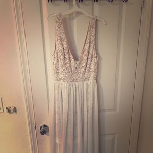 Ivory dress with added lace detail on chest area